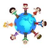 Милые счастливые дети над планетой земли Стоковое фото RF