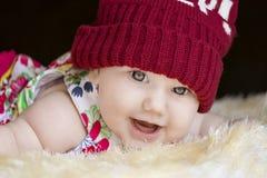 Милые счастливые лож младенца Стоковое Фото