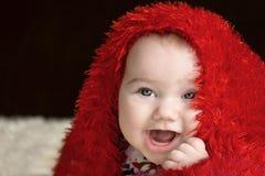 Милые счастливые лож младенца Стоковые Фото