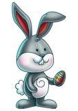 Милый зайчик держа пасхальное яйцо 1 Стоковое Фото