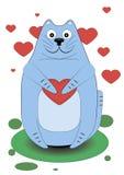 Милый кот держа сердце в его лапках Стоковые Фотографии RF