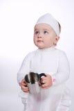 Милый маленький кашевар на белой предпосылке Стоковые Фото