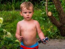 Милый малый мальчик на каникулах в внешнем Стоковое Изображение