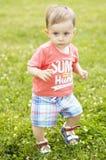 Милый малый мальчик на траве Стоковая Фотография RF
