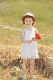 Милый малыш с цветками Стоковое Изображение RF