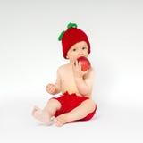 Милый малыш с яблоком Стоковое Изображение