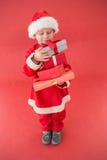 Милый мальчик в костюме santa Стоковые Изображения
