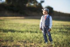 Милый мальчик в поле Стоковые Изображения