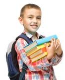 Милый мальчик держит книгу Стоковое Изображение