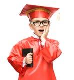 Милый мальчик держит книгу Стоковая Фотография