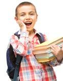 Милый мальчик держит книгу Стоковые Фотографии RF
