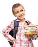 Милый мальчик держит книгу Стоковые Изображения