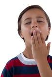 Милый мальчик зевая Стоковые Изображения RF