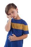 Милый мальчик имея боль в животе стоковые изображения rf