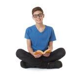 Милый мальчик подростка над предпосылкой изолированной белизной Стоковые Изображения