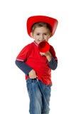 Милый молодой мальчик в шлеме пожарного Стоковые Фотографии RF
