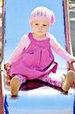 Милый младенец на спортивной площадке Стоковое фото RF