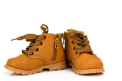 Милый младенец boots ботинки на белой предпосылке Стоковое фото RF