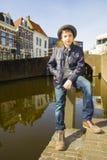 Милый подросток в шляпе (без сокращений портрет) Стоковое фото RF