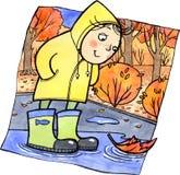 Милый ребенок стоя в лужице Стоковая Фотография
