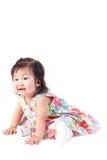 Милый ребёнок сидя в студии стоковое изображение