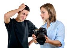 Милый фотограф женщины и его студент стоковые фото