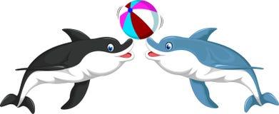 Милый шарж 2 дельфинов играя шарик Стоковые Изображения