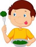 Милый шарж мальчика ест овощ используя вилку иллюстрация штока