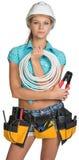 Милый электрик в шлеме, шортах, рубашке, инструменте Стоковое Изображение RF
