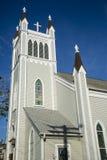 Милый Steeple церков против темносинего неба Стоковые Фото