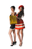2 милых девушки держа хозяйственные сумки Стоковая Фотография