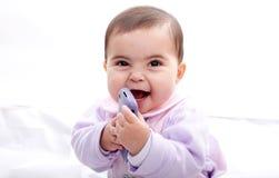 Младенец говоря на мобильном телефоне Стоковые Фотографии RF