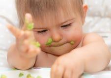 Младенец, есть, человеческое лицо, кавказская этничность 3 Стоковая Фотография RF