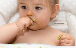 Младенец, есть, человеческое лицо, кавказская этничность 6 Стоковая Фотография RF