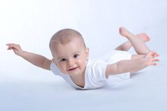 младенец летая счастливая белизна Стоковое Изображение RF