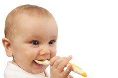 младенец подавая ложка Стоковые Изображения