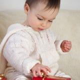 младенец присутствующий Стоковое Изображение