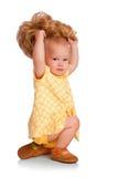 младенец пробует парик Стоковое фото RF