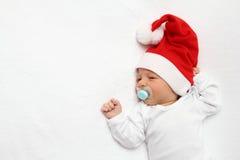 Младенец с шлемом Дед Мороз Стоковые Изображения