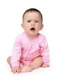 младенец displeased усаживание девушки Стоковая Фотография