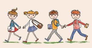 Младшие студенты идут к школе Стоковая Фотография