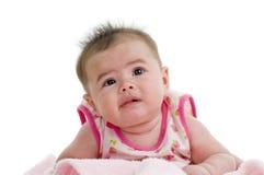 младенец смотря multi расовое поднимающее вверх Стоковое Фото