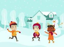 Многокультурные дети играя бой снежного кома Стоковое фото RF