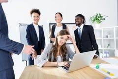 Многонациональные коллеги имея деловую встречу Стоковое Изображение
