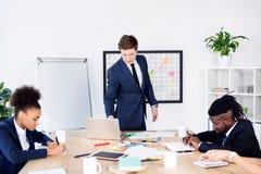 Многонациональные коллеги на деловой встрече Стоковое Изображение RF