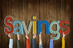 Многонациональная группа в составе руки держа сбережения слова Стоковое Фото