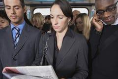 Многонациональные регулярные пассажиры пригородных поездов в поезде Стоковое Изображение RF