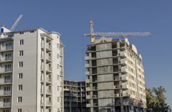 Многоэтажные здания в различных этапах конструкции Стоковая Фотография RF