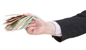 Много банкнот евро в руке бизнесмена Стоковое фото RF
