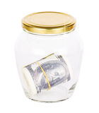 Много бумажных денег долларов в стекле Стоковая Фотография